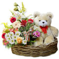 assorted flowers with bear